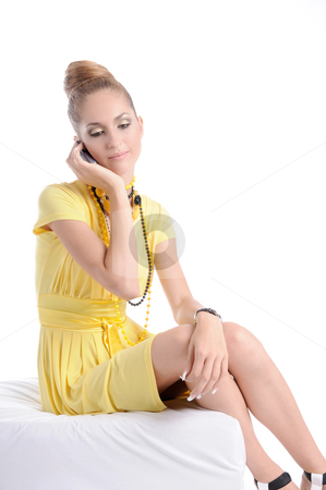 Waiting_For_Answer stock photo, Fashion dressed beautiful girl in yellow dress give a phone call by Valeriy Mazur