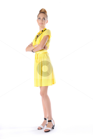 Look Up stock photo, Fashion dressed beautiful girl in yellow dress isolated on white background by Valeriy Mazur