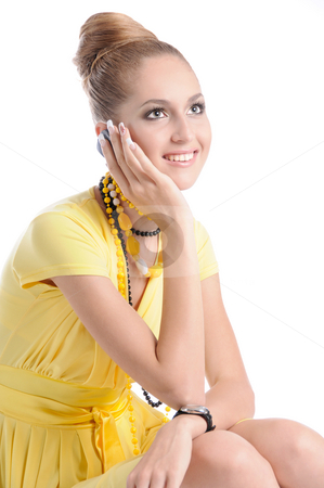 Phone Conversation stock photo, Fashion dressed beautiful girl in yellow dress give a phone call by Valeriy Mazur