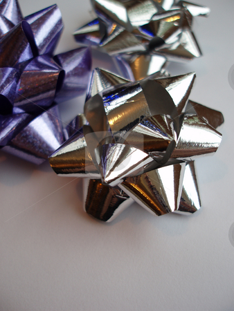 Ribbon bows stock photo, Silver and purple present wrapping ribbons by Stephen Gibson