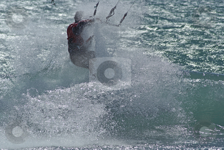 Spray stock photo, Kiteboarder in the wave at full speed by Serge VILLA