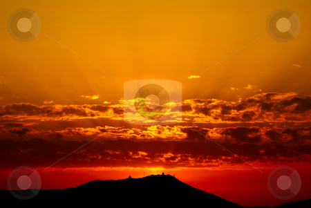 Red Sunset stock photo, Red sunset with rays of Sun in French Riviera. by Serge VILLA