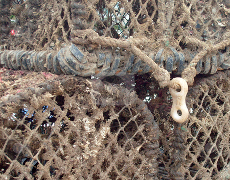 Lobster Pot stock photo, Portrait of lobster pot seen in detail in harbor. by Martin Crowdy