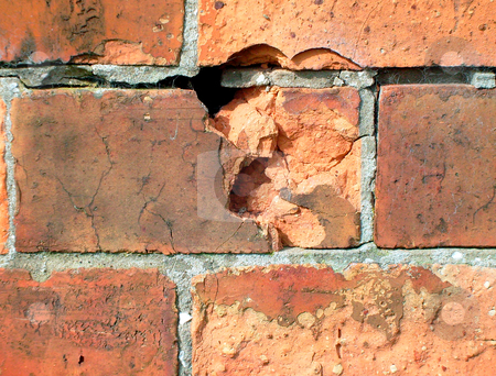 Weathered bricks stock photo, Detail of weathered brick in traditional wall. by Martin Crowdy