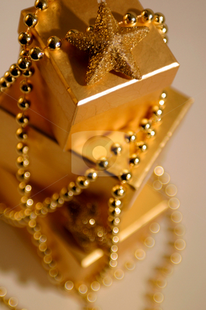 Birthday Presents stock photo, Three birthday presents wrapped in gold paper. by Martin Crowdy
