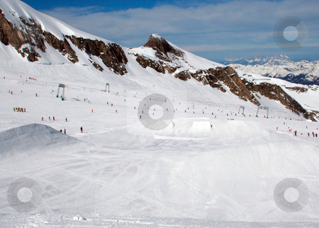 Skiers in Swiss Alps stock photo, Skiers in Swiss Alps mountain snow, winter scene. by Martin Crowdy
