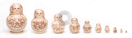 Russian Nesting Dolls stock photo, Colorful russian nesting dolls isolated on a white background by Vlad Podkhlebnik