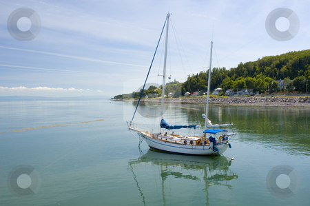 Sail boat stock photo, Sail boat on a calm river surrounded by a mountain by Vlad Podkhlebnik