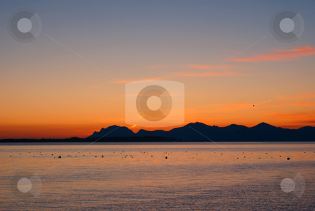 Colored Sunset stock photo, Winter Sunrise in French Riviera (South-East of France). View from the City of Cannes. by Serge VILLA
