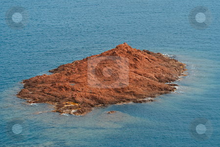 Island stock photo, Small red rock island surrounded by Mediterranean sea by Serge VILLA