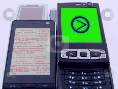 Two Modern Mobile Phones PDA Showing Source Code Programming  stock photo, Two Modern Mobile Phones PDA Showing Source Code Programming by Robert Davies