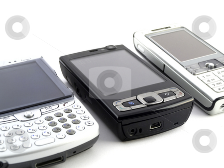 Modern Mobile Phones on White Background stock photo, Several Modern Mobile Phones on White Background by Robert Davies