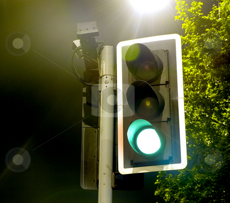 Traffic Lights near a Bright Lamp at Night stock photo, Traffic Lights near a Bright Lamp at Night by Robert Davies