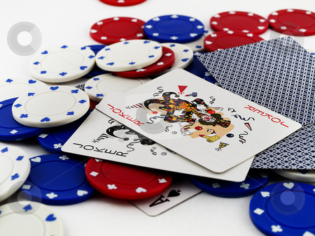 Poker Chips and Joker Cards on White Background stock photo, Poker Chips and Joker Cards on White Background by Robert Davies