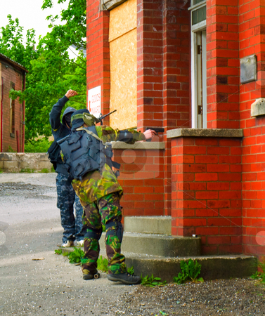 Men with Guns Attacking Doorway stock photo, Military Airsoft Event by Robert Davies