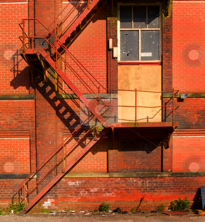 Rusty Old Fire Escape Stairs on Warehouse stock photo, Rusty Old Fire Escape Stairs on Warehouse by Robert Davies
