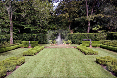 Garden Fountain stock photo, An english garden with a fountain spraying in the center by Kevin Tietz