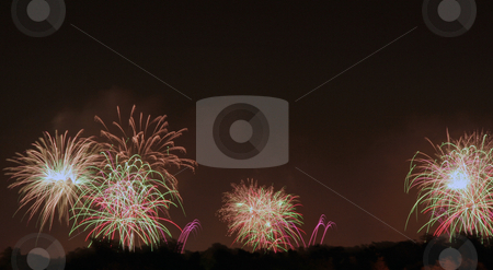 Fireworks Display stock photo, A firework display that was shot off in three locations by Kevin Tietz