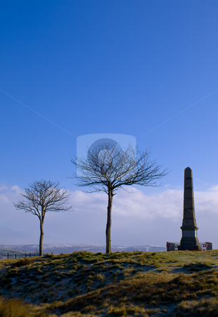 War Monument and Trees on Horizon at Dawn stock photo, War Monument and Trees on Horizon at Dawn Bright Blue Sky by Robert Davies