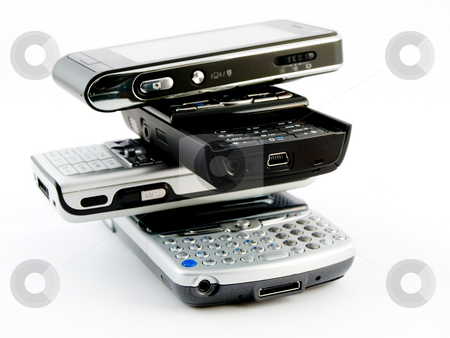 Stack Pile of Several Modern Mobile Phones PDA Cell Handheld Uni stock photo, Stack Pile of Several Modern Mobile Phones PDA Cell Handheld Units Isolated on White Background by Robert Davies