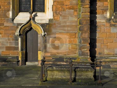 Orange Brick Church with Grave stock photo, Orange Brick Church with Grave and Wooden Doorway by Robert Davies
