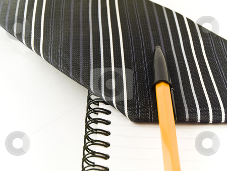 Ballpoint Pen and Tie on Notebook White Background stock photo, Ballpoint Pen and Tie on Notebook White Background by Robert Davies