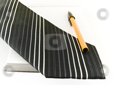 Ballpoint Pen and Tie on Notepad on White Background stock photo, Ballpoint Pen and Tie on Notepad on White Background by Robert Davies