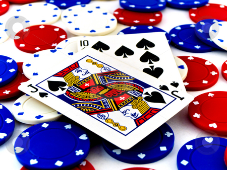 Red White and Blue Poker Chips and Black Jack on White Backgroun stock photo, Red White and Blue Poker Chips and Black Jack on White Background by Robert Davies