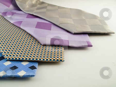 Close Up Neck Ties Showing Pattern stock photo, Close Up Neck Ties Showing Silk Pattern on Rich Cloth by Robert Davies
