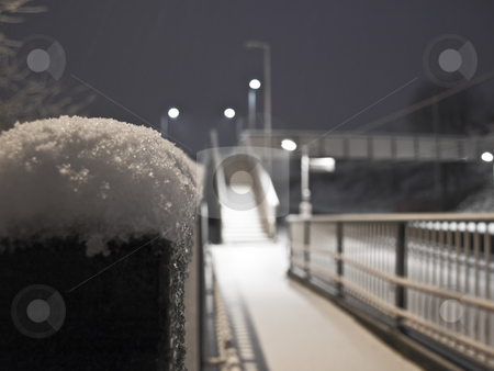 Fence With Snow on Top Near Railings stock photo, Fence With Snow on Top Near Railings and Stairway on Railway Station by Robert Davies