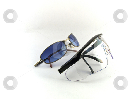 Sunglasses and Safety Goggles on White Background stock photo, Sunglasses and Safety Goggles on White Background by Robert Davies