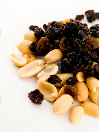 Stack Pile of Peanuts and Raisins on White Background stock photo, Stack Pile of Peanuts and Raisins on White Background No Shells or Coating by Robert Davies