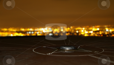 Compass Monument Overlooking Cityscape stock photo, Compass Monument Overlooking Cityscape at Night by Robert Davies