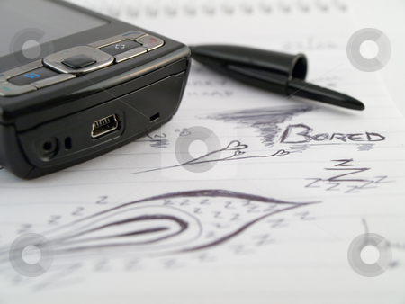 Doodle Sketch Lined Work Business Notepad With Bored Drawings an stock photo, Doodle Sketch Lined Work Business Notepad With Bored Drawings and Mobiles Phone PDA by Robert Davies