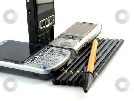 Mobile Phones Pens and Pencils on White Background stock photo, Modern Mobile Phones Pens and Pencils on White Background by Robert Davies