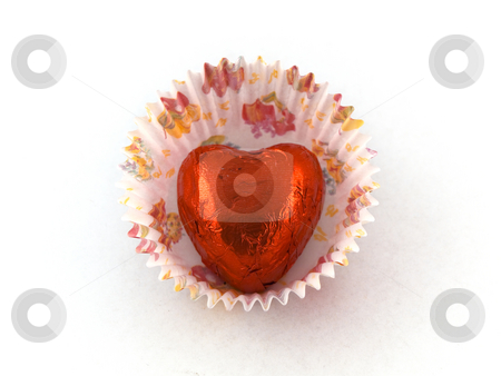 Red Heart Chocolate in Paper Cake Case stock photo, Red Heart Chocolate in Paper Cake Case by Robert Davies