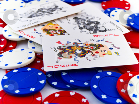 Red White and Blue Poker Chips and Jokers on White Background stock photo, Red White and Blue Poker Chips and Jokers on White Background by Robert Davies