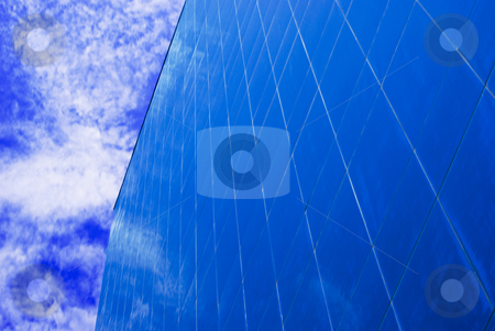 Blue on Blue Building stock photo, Perspective on a blue Corporate office building with sky reflecting on windows by Robert Cabrera