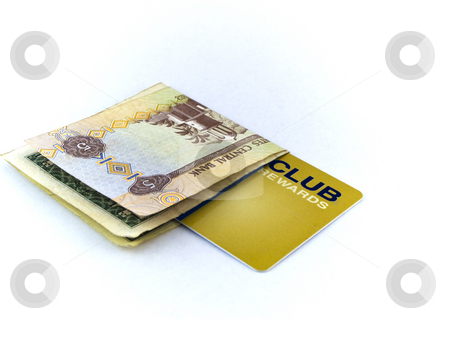 Five Dirham Note and Gold Membership Club Card on White Backgrou stock photo, Five Dirham Note and Gold Membership Club Card on White Background by Robert Davies