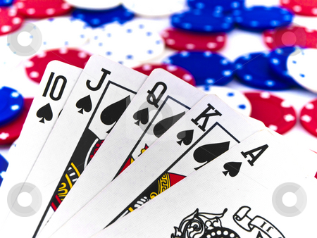Red White and Blue Poker Chips and Royal Flush on White Backgrou stock photo, Red White and Blue Poker Chips and Royal Flush on White Background by Robert Davies