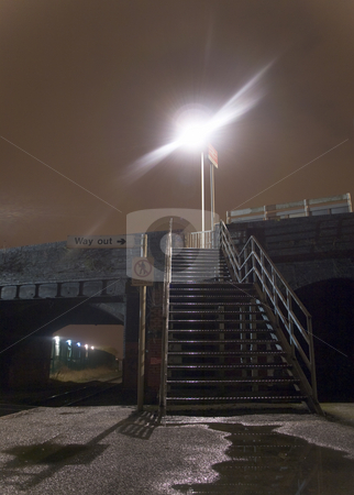 Steel Steps on Train Platform at Night stock photo, Steel Steps on Train Platform at Night With Lamp post by Robert Davies