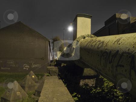 Vandalised Gas Pipe near Grass at Night stock photo, Vandalised Gas Pipe near Grass at Night in Manchester UK by Robert Davies