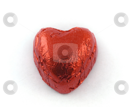 Heart Shaped Chocolate in Red Tin Foil stock photo, Heart Shaped Chocolate in Red Tin Foil by Robert Davies
