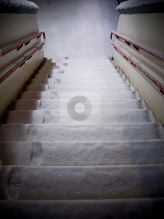 Steps Covered With Snow and Footprints stock photo, Steps Covered With Snow and Footprints With Red Hand Rail by Robert Davies