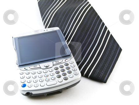 PDA Mobile Phone and Tie on White Background stock photo, Mobile Phone and Tie on White Background by Robert Davies