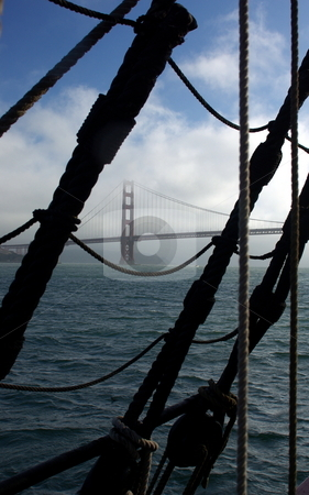 Golden Gate Bridge  stock photo, Golden Gate Bridge viewed through a sailing ships rigging when leaving the bay. by Lynn Bendickson