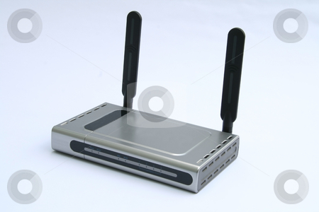 Wireless modem  stock photo, Wireless modem and router isolated on white background by Jonas Marcos San Luis