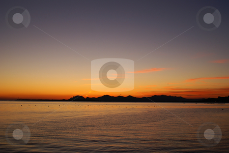Sunset on Esterel stock photo, Typical winter sunset in French riviera. View of the Esterel from the city of Cannes. by Serge VILLA