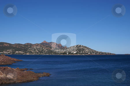 Agay Bay stock photo, Red rock and blue sea for the Mediterranean coast in French Riviera. Esterel Coast by Serge VILLA