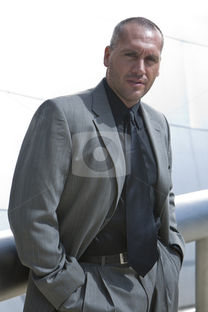 Business Man Series stock photo, Fashion model posing as business man in front of high tech building by Csaba Fikker